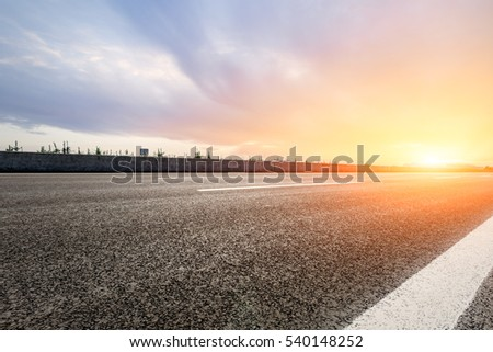 countryside asphalt road at sunset #540148252