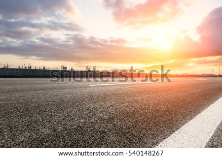 countryside asphalt road at sunset #540148267
