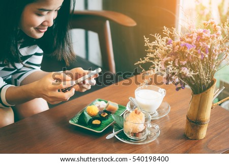 Point of view of a young woman taking a photo of her food with her smartphone. Picture of food on screen.