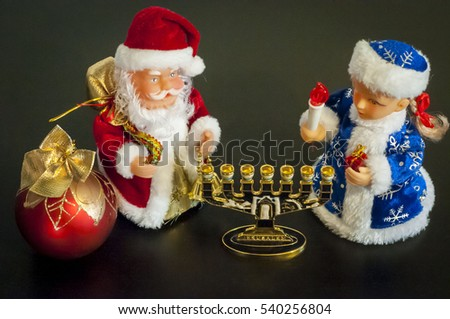 Toy statues of Ded Moroz (Santa Claus) and Snegurochka next to the Hanukkah menorah (hanukkiah). In December 2016 two holidays - Christmas and New Year coincide with the Jewish Hanukkah.