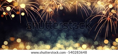 Gold and dark blue Fireworks and bokeh in New Year eve and copy space. Abstract background holiday. #540283648