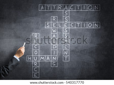 Business concept with crossword drawn with chalk on blackboard #540317770
