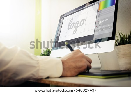 designer designing a logo. All screen graphics are made up.