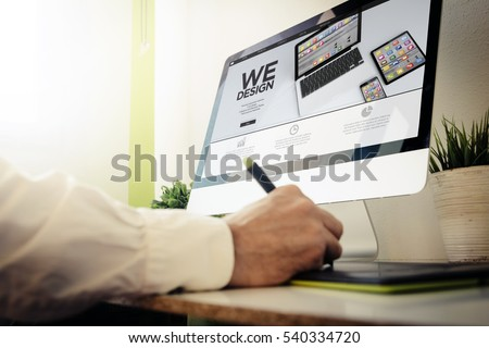 web developer designing a responsive website. All screen graphics are made up.