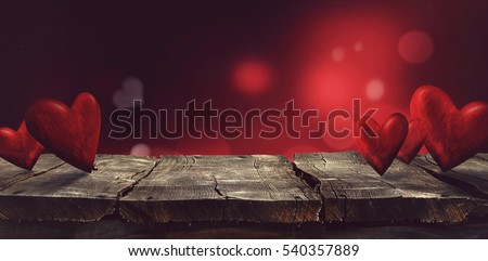 Valentines day. Valentines background with table and bokeh. Love red background. Valentines day empty display #540357889