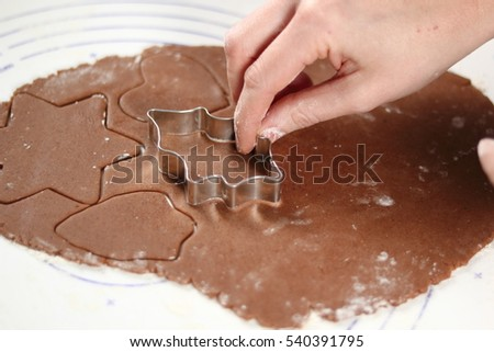 Cutting dough sheet into shapes. Making Gingerbread Cookies Series. #540391795