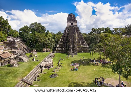Tourists at the Gran Plaza at the archaeological site Tikal, Guatemala.  #540418432
