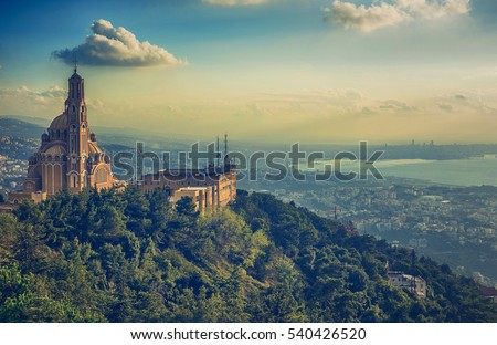 Cloudy View on a historic old church in Lebanon Royalty-Free Stock Photo #540426520