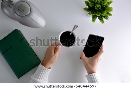 view overhead of person buying by internet with your smartphone while takes a coffee #540444697