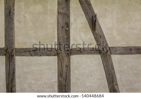Old adobe wall of the half timbered house. #540448684