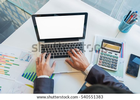 Male person sitting front open laptop computer with blank empty screen for your information or content,modern businessman work in internet via notebook. #540551383