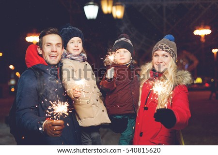 Beautiful family with burning sparklers #540815620