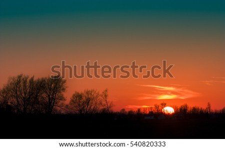 perfect sunset over a forest with a house #540820333