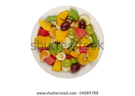 Tropical fruit salad on white plate on white background photographed from above (Isolated) #54089788