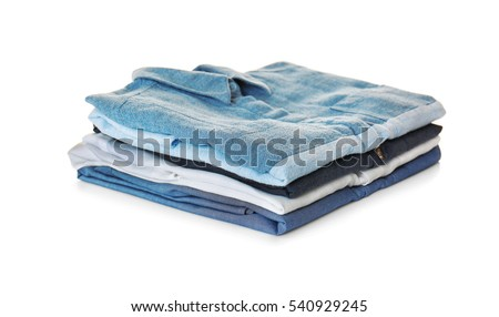 Stack of colorful shirts on white background #540929245