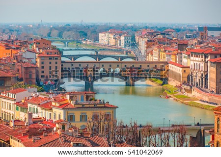 Ponte Vecchio over Arno river in Florence, Italy #541042069