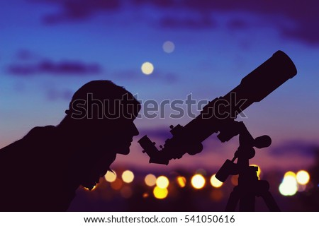 Girl looking at the stars with telescope beside her and de-focused city lights. My astronomy work. Royalty-Free Stock Photo #541050616