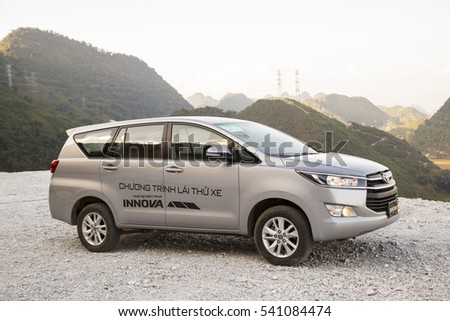 Hanoi, Vietnam - Nov 19, 2016: Toyota Innova 2016 car on test drive road in Vietnam #541084474