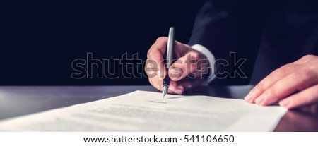 Businessman Signing An Official Document