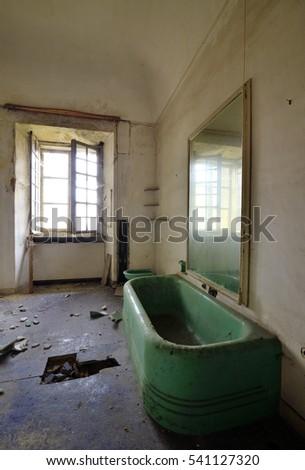 Old abandoned bathroom with window #541127320