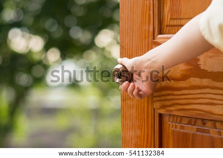 Women hand open door knob or opening the door. Royalty-Free Stock Photo #541132384