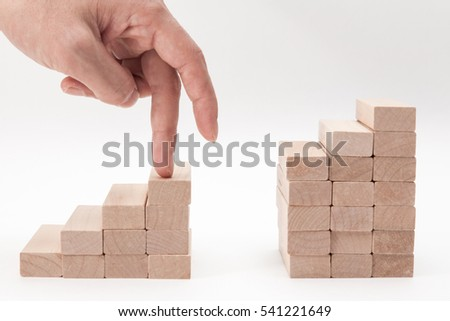 man hand finger walk on stacked wooden block on white backgrounds #541221649