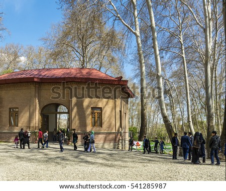 TEHRAN, IRAN â?? March 31, 2016: Visitors in front of Omidvar Brothers Museum in Sadabad complex. The complex includes natural forest, galleries and museums, built by the Qajar and Pahlavi monarchs. #541285987