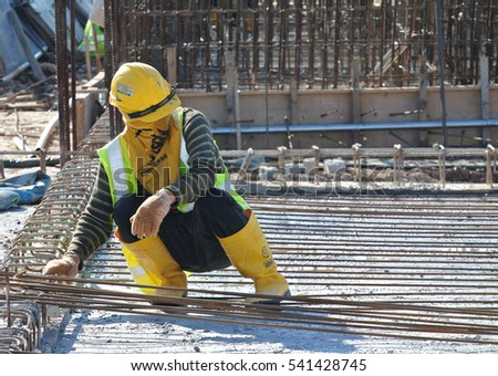 MALACCA, MALAYSIA -SEPTEMBER 24, 2016: Construction workers fabricating floor slab reinforcement bar at the construction site in Malacca, Malaysia.   #541428745