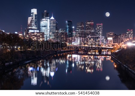 Moon over the Philadelphia night skyline reflects on the Schuylkill river