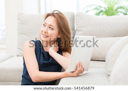 Beautiful young asian woman using tablet computer #541456879