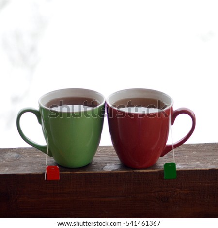 Two cups with tea bag in winter background #541461367