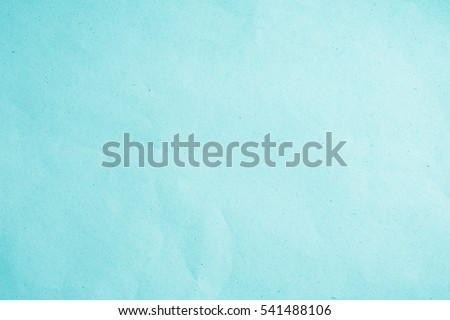 Smooth flat vintage paper bag pale texture in light blue color on table background. Organic soft turquoise plain back craft book concept for simplicity azure teal scrap backdrop, black simple surface Royalty-Free Stock Photo #541488106