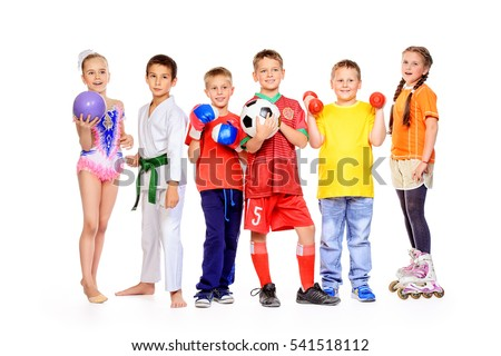 Sports and activities for children. Group of joyful boys and a girls engaged in various sports posing together. Education. Isolated over white background. Royalty-Free Stock Photo #541518112