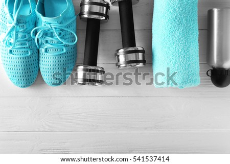 Fitness equipment on wooden background #541537414