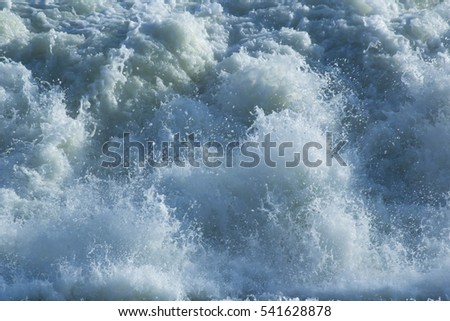 water foaming from dam look high power and dangerous for background and texture #541628878