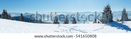 Beautiful European winter mountains in Alps, Beautiful alpine panoramic view snow capped mountains, Slope for cross country skiers in landscape #541650808