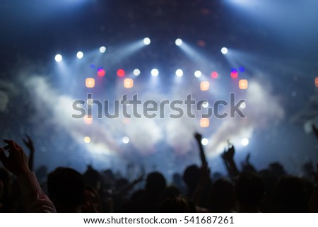 Effects blur Concert, disco dj party. People with hands up having fun  #541687261