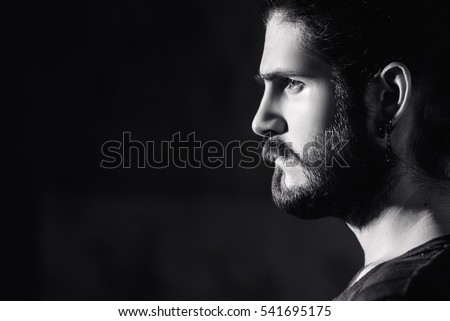 young bearded hipster man. facial profile.  Royalty-Free Stock Photo #541695175