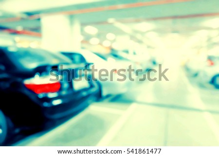 Blur image of car in parking lot. #541861477