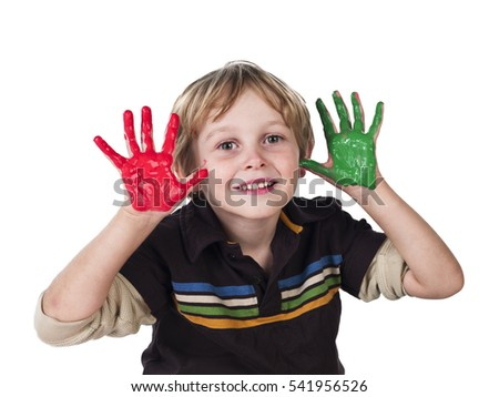 Cute young boy playing with water colors isolated on white background.  Creative education concept #541956526