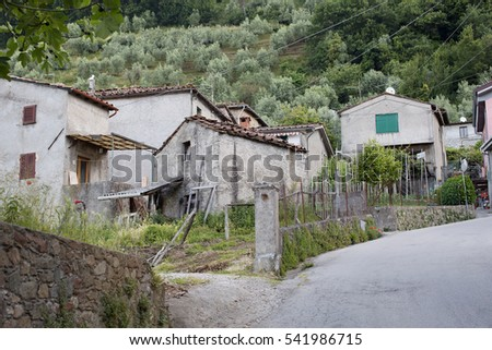 Benabbio, Italy-June 3, 2015. View of homes in the historic village of Benabbio in the Province of Lucca, Tuscany, Italy #541986715
