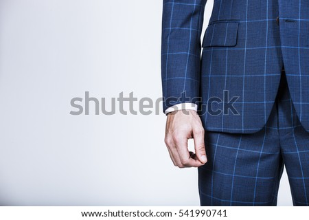 Detail of a businessman's hand with blue suit jacket #541990741