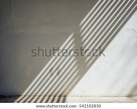 The sun is casting over the white concrete wall,sunshade shadow #542102830