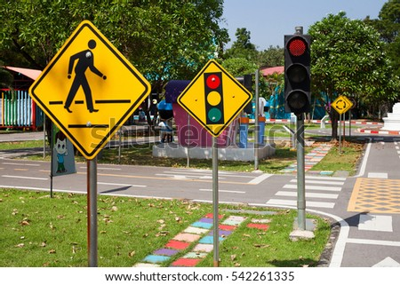 Traffic signs teach your child to the park. Traffic light