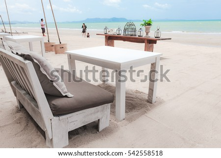 Sofa and table on the beach in Pattaya, Thailand. #542558518