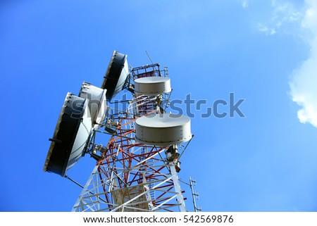 upward of Communication  Radio antenna Tower , microwave antenna tower on blue sky background #542569876