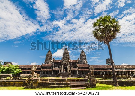 The famous Angkor Wat temple with a palm tree in the foreground #542700271