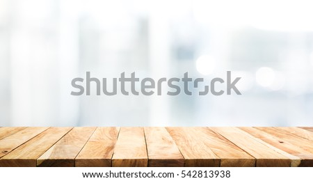 Wood table top on blur glass window wall building background.For montage product display or design key visual layout background. Royalty-Free Stock Photo #542813938