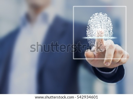 Fingerprint scan provides security access with biometrics identification, person touching screen with finger in background Royalty-Free Stock Photo #542934601
