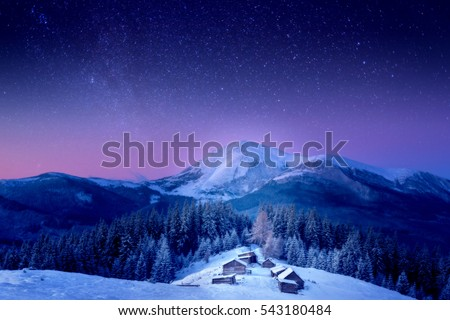 A small village in the Carpathian Mountains, fabulous views, new year's Christmas look, the Milky Way, behind Petros Mountain, Ukraine, Carpathian Mountains #543180484